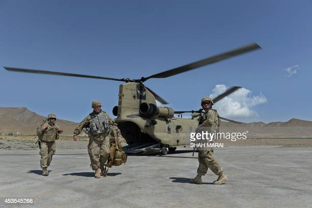 This photo taken on August 11 2014 US soldiers part of the NATOled International Security Assistance Force walk from a Chinook helicopter in the...