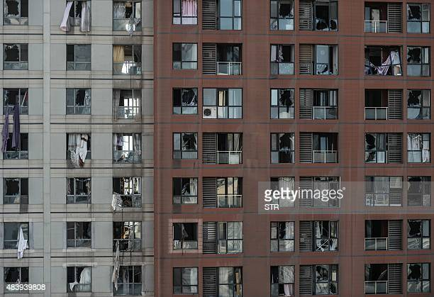 This photo taken on August 13 2015 shows a damaged apartment building near the site where a series of explosions at a chemical warehouse hit the city...