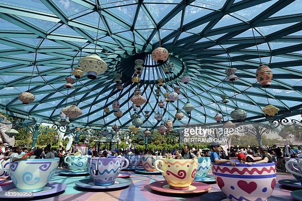This photo taken on August 13 2015 shows the Mad Hatter's Tea Cup ride at The Walt Disney Studios park at Disneyland Paris in MarnelaVallee AFP PHOTO...