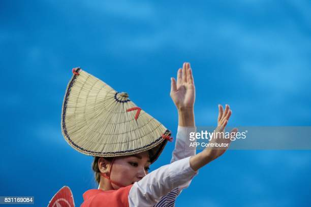This photo taken on August 13 2017 shows a dancer performing during the Awa Odori festival in Tokushima The fourday dance festival attracts more than...