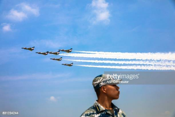 This photo taken on August 13 2017 shows China's Bayi Aerobatic Team performing in the sky during the Chinese People's Liberation Army Air Force...