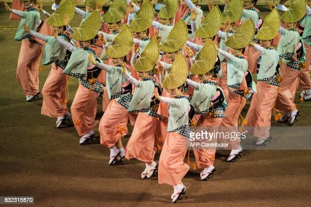 This photo taken on August 15 2017 shows dancers of Uzukiren performing during the Awa Odori festival in Tokushima The fourday dance festival...