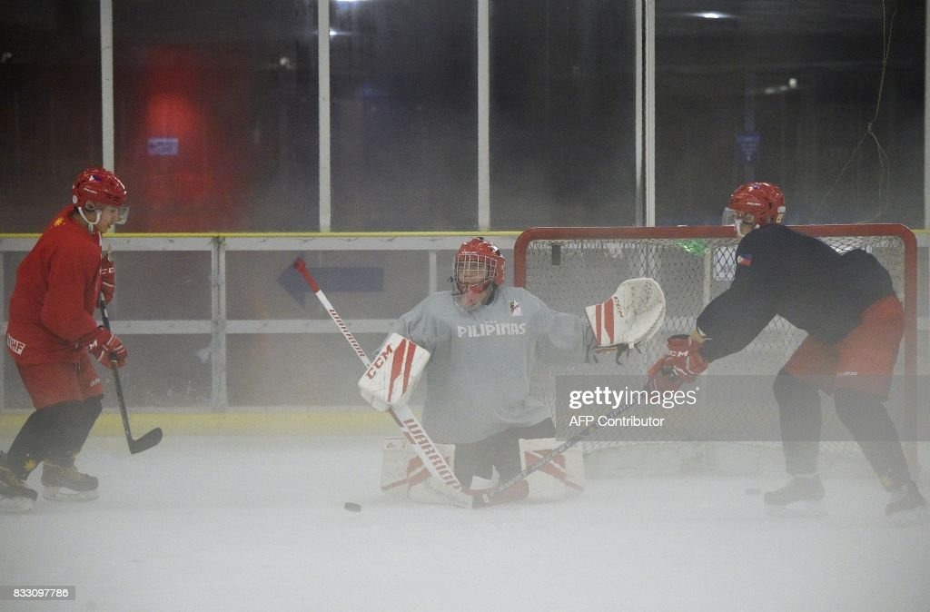 This photo taken on August 15, 2017 shows members of the Philippines men's ice hockey team, dubbed the 'Mighty Ducks', during a practice session at a mall skating rink in Manila ahead of their games at the Southeast Asian Games (SEAGames) in Malaysia. Dubbed the 'Mighty Ducks' by local media, the Philippine men's hockey team aims to win a gold medal in next week's games in Malaysia -- a far cry from members' days of only learning of the sport through the Disney movies. / AFP PHOTO / TED ALJIBE / TO GO WITH SEAGames-PHI-IHockey by Ayee MACARAIG