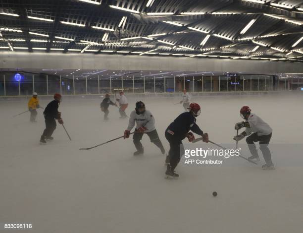 This photo taken on August 15 2017 shows members of the Philippines men's ice hockey team dubbed the Mighty Ducks during a practice session at a mall...
