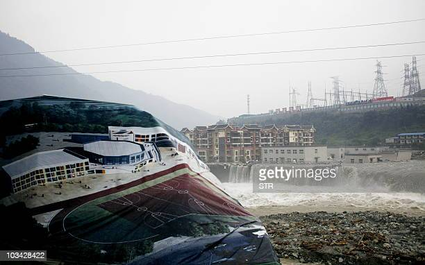 This photo taken on August 17 2010 shows newlybuilt houses flooded in Yingxiu town the epicentre of the Sichuan earthquake in southwest China's...
