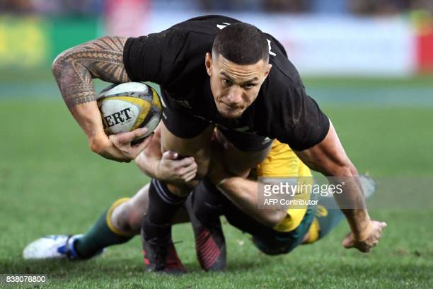 TOPSHOT This photo taken on August 19 2017 shows New Zealand's All Blacks centre Sonny Bill Williams being tackled during their Rugby Championship...