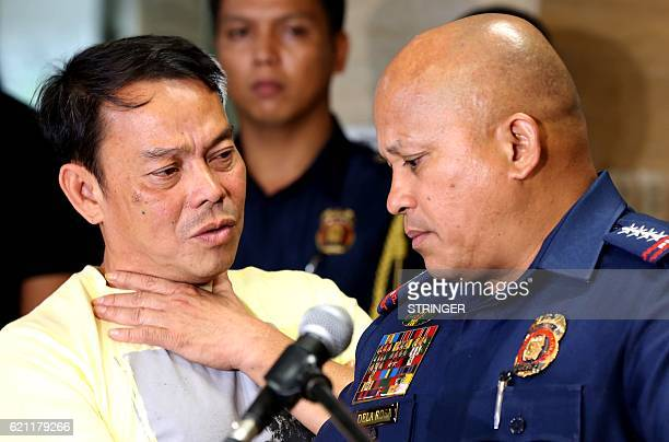 This photo taken on August 2 shows Leyte Albuera Mayor Ronaldo Espinosa talking to Philippine National Police chief Ronald dela Rosa at Camp Crame in...