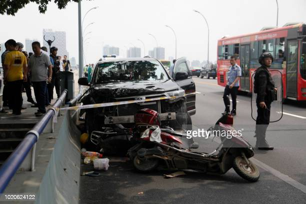 This photo taken on August 20 2018 shows a damaged car after a crash in Liuzhou in China's southern Guangxi region The driver who was escaping after...