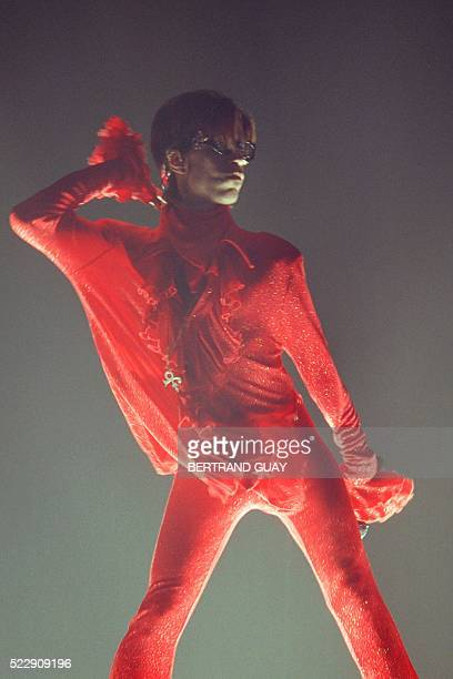 This photo taken on August 21 1998 shows musician Prince performing on stage during his concert in Paris Pop icon Prince whose pioneering brand of...