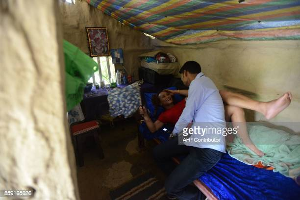 This photo taken on August 21 2017 shows Nepali transgender person Monika Shahi Nath Yogi and her husband Ramesh Nath Yogi talking in a bedroom in...