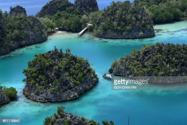 This photo taken on August 21 2017 shows the blue waters in Raja Ampat which means Four Kings in Indonesian in Indonesia's far eastern Papua...