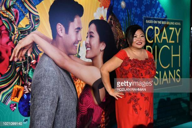 This photo taken on August 21 2018 shows Singaporean performer Selena Tan posing at the premier of the film 'Crazy Rich Asians' at the Capitol...