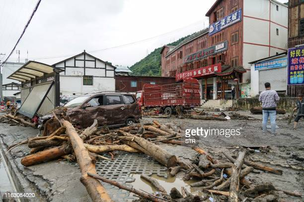 This photo taken on August 21, 2019 shows the aftermath of a mudslide caused by heavy rainfall in Wenchuan county, in China's southwestern Sichuan...