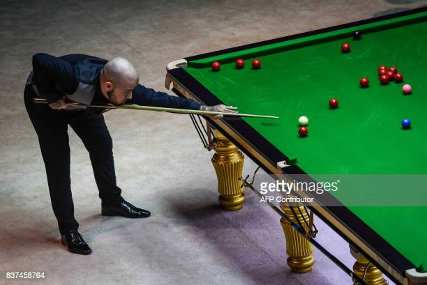 This photo taken on August 22 2017 shows Luca Brecel of Belgium playing a shot during the final of the World Snooker China Championship in Guangzhou...
