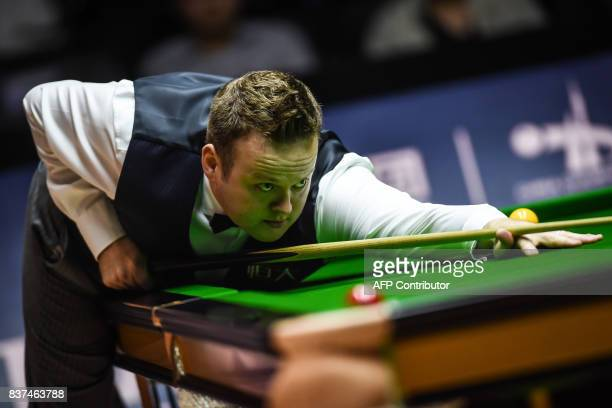 This photo taken on August 22 2017 shows Shaun Murphy of Britain playing a shot during the final of the World Snooker China Championship in Guangzhou...