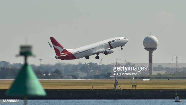This photo taken on August 23 2017 shows a Qantas plane taking off from Sydney airport Australian carrier Qantas posted healthy annual net profits on...