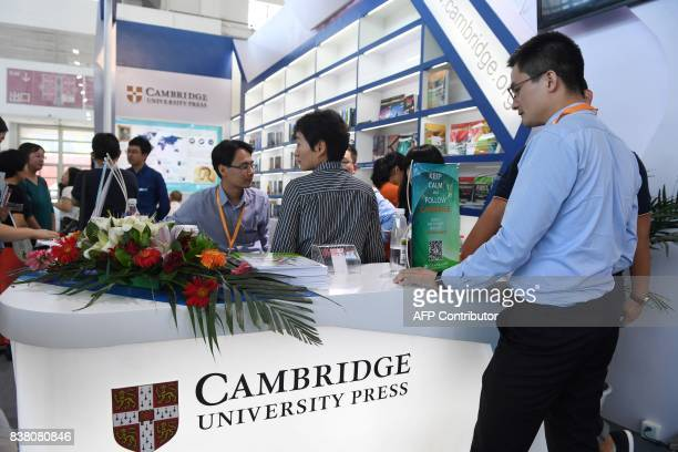 This photo taken on August 23 2017 shows people at the Cambridge University Press stand at the Beijing International Book Fair in Beijing Just days...