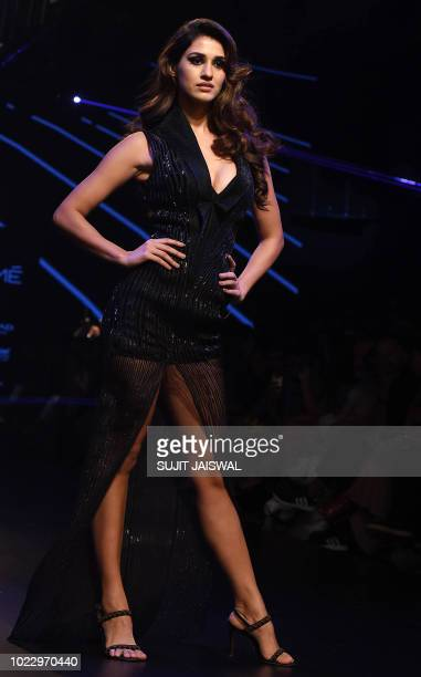 This photo taken on August 24 2018 shows Indian Bollywood actress Disha Patani showcasing a creation by designer Amit Aggarwal at the Lakmé Fashion...