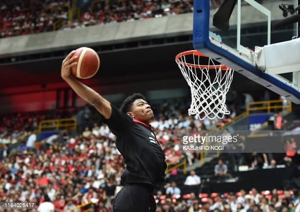 This photo taken on August 24, 2019 shows Japan's Rui Hachimura warming up before a basketball match between Japan and Germany at Saitama Super...