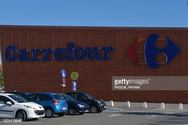 This photo taken on August 27 2018 shows a sign of a Carrefour supermarket in Toulouse southern France