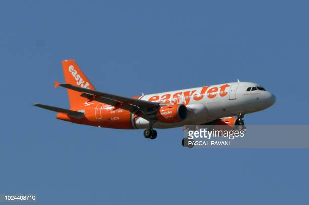 This photo taken on August 27 2018 shows an Airbus A319 of EasyJet as it flies above Toulouse southern France