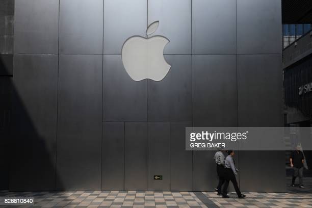 This photo taken on August 3 2017 shows women walking past an Apple store in Beijing Enterprising internet users in China fear the tools they use to...