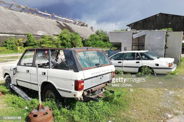 This photo taken on August 30 2018 shows abandoned cars in Aiwo on the Pacific island of Nauru Official talks at the 18nation Pacific Islands Forum...