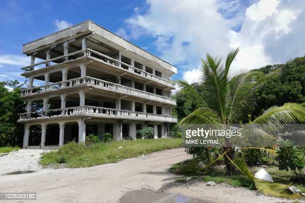 This photo taken on August 30 2018 shows an abandoned building on the Pacific island of Nauru Official talks at the 18nation Pacific Islands Forum...