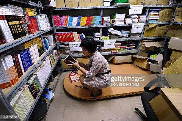 This photo taken on August 31 2010 shows a member of staff of the publishing house Tri Thuc reading a book at their office in Hanoi on August 31 2010...