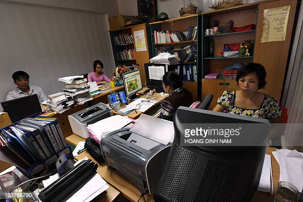 This photo taken on August 31 2010 shows staff of the publishing house Tri Thuc working at their desks in Hanoi The title of French author Alexis de...