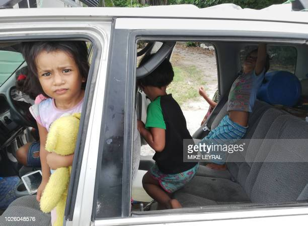 This photo taken on August 31 2018 shows children in a car in Yaren on the Pacific island of Nauru Official talks at the 18nation Pacific Islands...