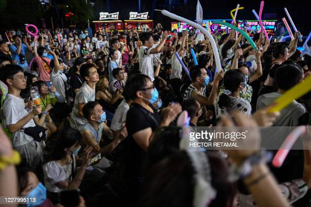 This photo taken on August 4, 2020 shows people participating in a music festival in Wuhan in Chinas central Hubei province. - The city's...