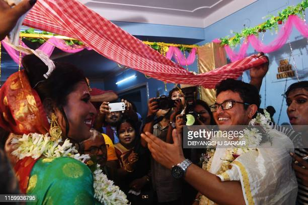 This photo taken on August 5 2019 shows transgender woman Tista Das 38 and transgender man Dipan Chakraborty performing the rituals of a traditional...