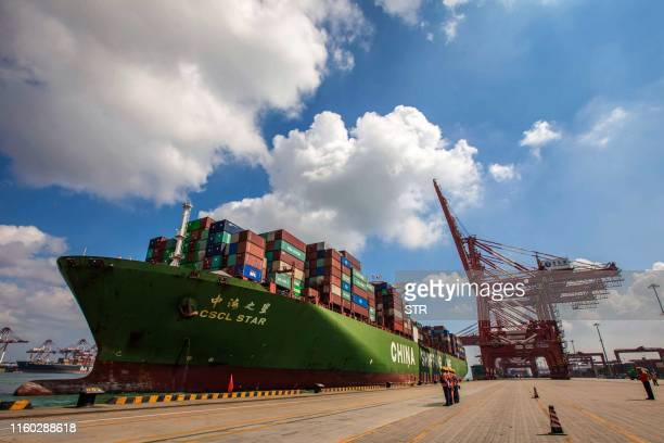 This photo taken on August 6 2019 shows a cargo ship berthing at Qingdao port in Qingdao in China's eastern Shandong province China's good shipments...