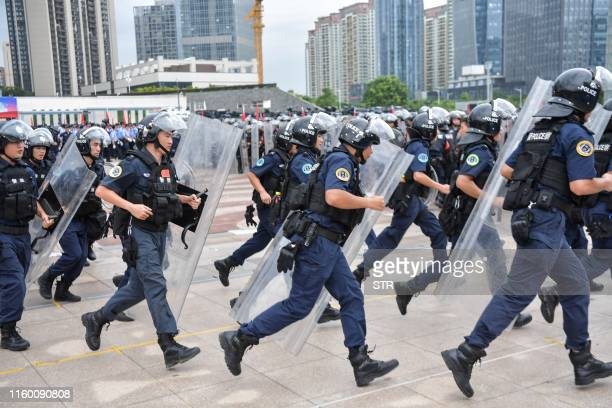 This photo taken on August 6 2019 shows Chinese police officers taking part in a drill in Shenzhen in China's southern Guangdong province across the...