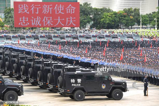 This photo taken on August 6, 2019 shows Chinese police officers taking part in a drill in Shenzhen in China's southern Guangdong province, across...