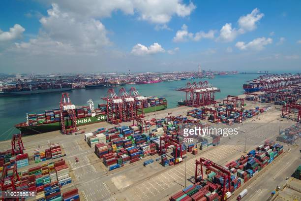 This photo taken on August 6 2019 shows containers stacked at Qingdao port in Qingdao in China's eastern Shandong province China's good shipments...