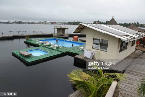 This photo taken on August 6 shows a general view of the Floating Island in Abidjan. - Ivory Coast announced on October 22 that Arab investors had...