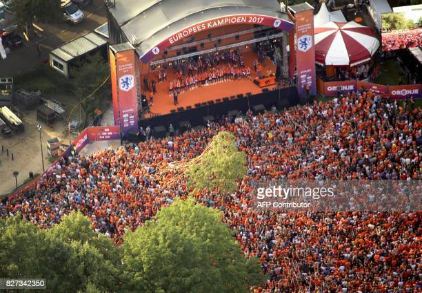 This photo taken on August 7 2017 shows an aerial view of The Netherland's women's soccer team on stage after winning the UEFA Women's Euro 2017...