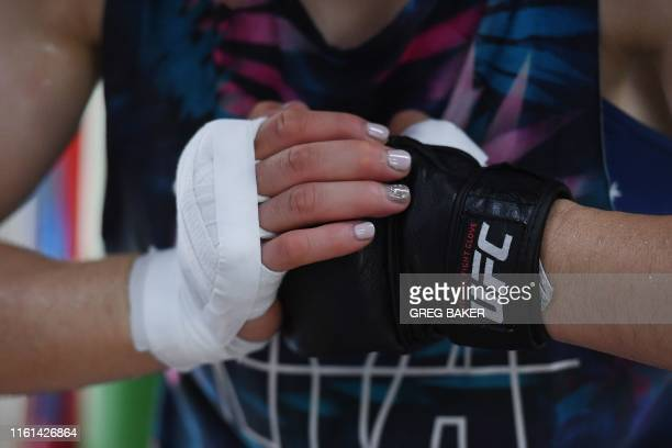 This photo taken on August 7 2019 shows Chinese mixed martial arts fighter Zhang Weili resting during a training session in a gym in Beijing Zhang...