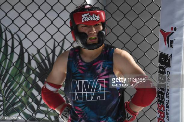This photo taken on August 7 2019 shows Chinese mixed martial arts fighter Zhang Weili during a break in training at a gym in Beijing Zhang can...