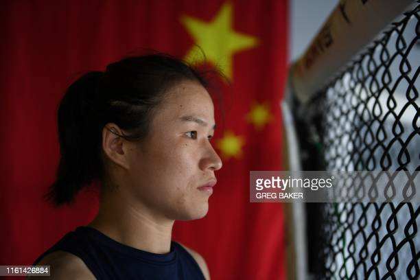 This photo taken on August 7 2019 shows Chinese mixed martial arts fighter Zhang Weili posing after a training session in Beijing Zhang can become...