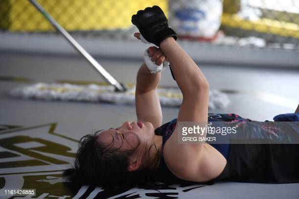This photo taken on August 7 2019 shows Chinese mixed martial arts fighter Zhang Weili resting during a break in training at a gym in Beijing Zhang...