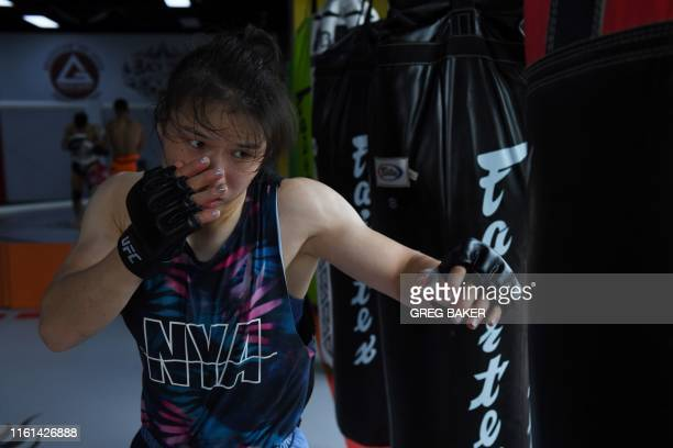 This photo taken on August 7 2019 shows Chinese mixed martial arts fighter Zhang Weili during a training session in a gym in Beijing Zhang can become...