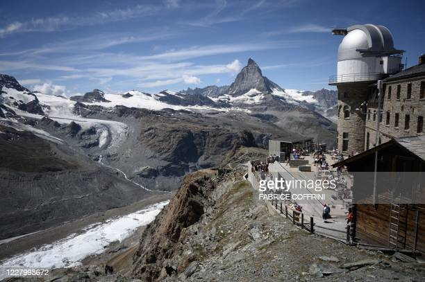This photo taken on August 8 from the Gornergrat, 3'089 meter hight above the resort of Zermatt shows a restaurant next to the observatory with the...
