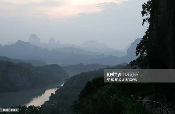 This photo taken on August 9 2006 shows a view of the valley below from a hiker's trail through the rock formations at Mount Danxia outside the city...