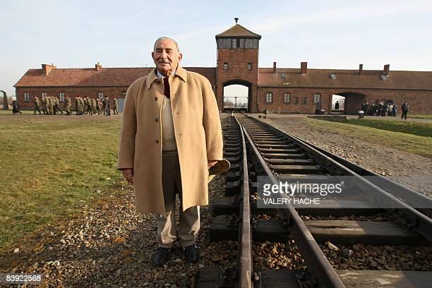 This photo taken on December 04 2008 at Auschwitz IIBirkenau former Nazi death camp in Oswiecim shows a survivor Charles Gottlieb born in 1925 is...