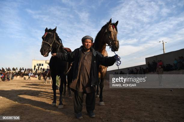 This photo taken on December 1 2017 shows an Afghan horseman preparing for a game of the traditional sport of buzkashi on the outskirts of Kabul The...