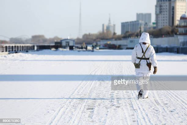 This photo taken on December 10 2017 shows a Chinese soldier patrolling in the snow along the border with Russia in Heihe in China's northeastern...
