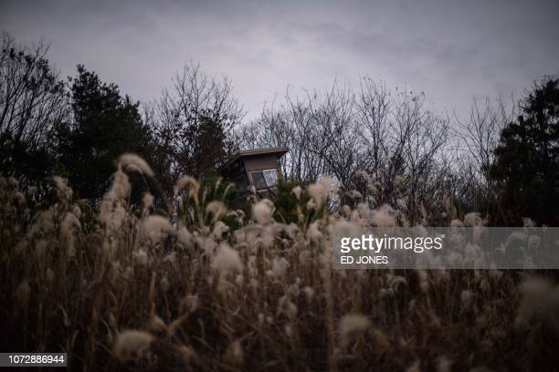 This photo taken on December 11, 2018 shows a guard post at Camp Greaves, a former US army camp within the buffer zone adjacent to the Demilitarized...